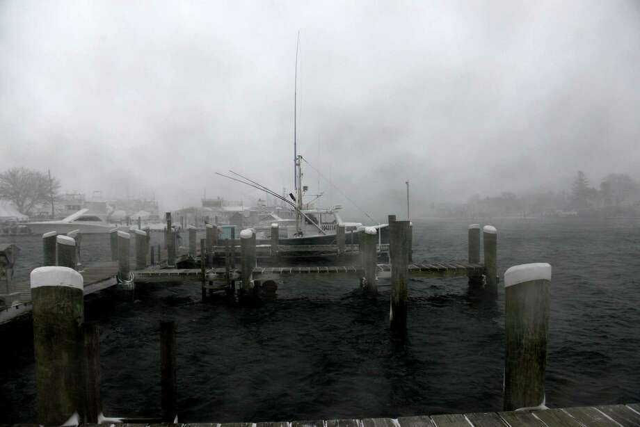 A boat sits moored in the harbor during a snowstorm March 26, 2014 in Hyannis, Massachusetts. An early spring storm brought high winds and some snow accumulation, with blizzard conditions expected to last throughout the morning. Photo: Darren McCollester, Getty Images / 2014 Getty Images