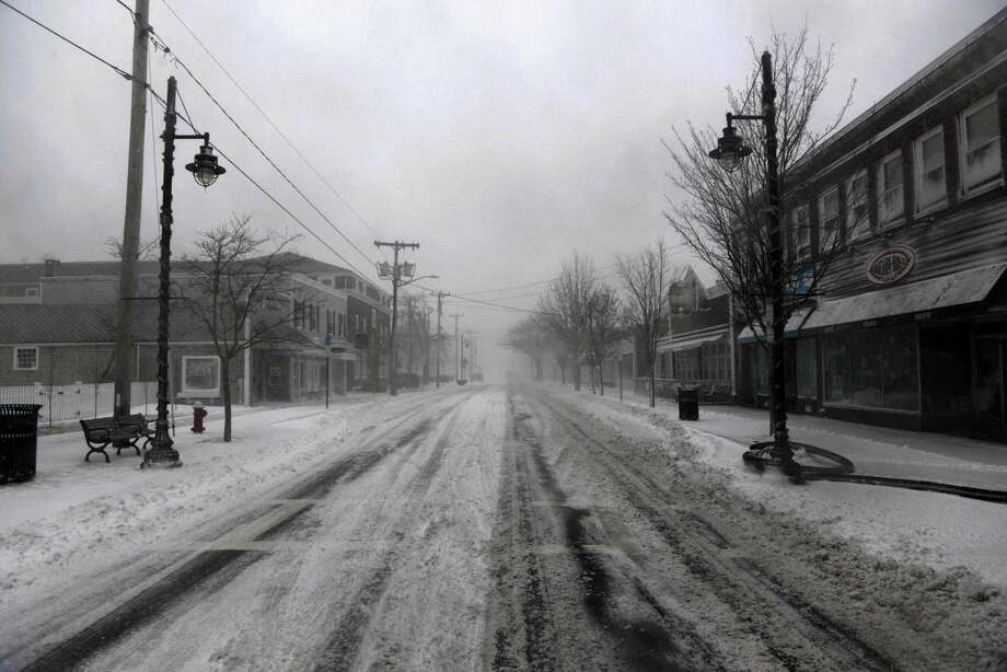 A snow swept Main Street is seen during a snowstorm March 26, 2014 in Hyannis, Massachusetts. An early spring storm brought high winds and some snow accumulation, with blizzard conditions expected to last throughout the morning. Photo: Darren McCollester, Getty Images / 2014 Getty Images