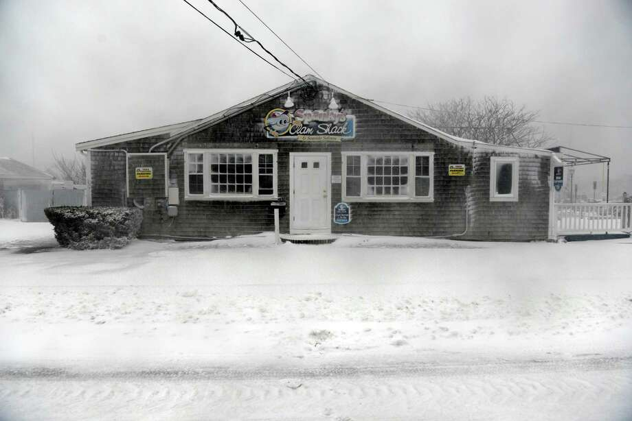 Spanky's Clam Shack is covered in wind swept snow during a snowstorm March 26, 2014 in Hyannis, Massachusetts. An early spring storm brought high winds and some snow accumulation, with blizzard conditions expected to last throughout the morning. Photo: Darren McCollester, Getty Images / 2014 Getty Images