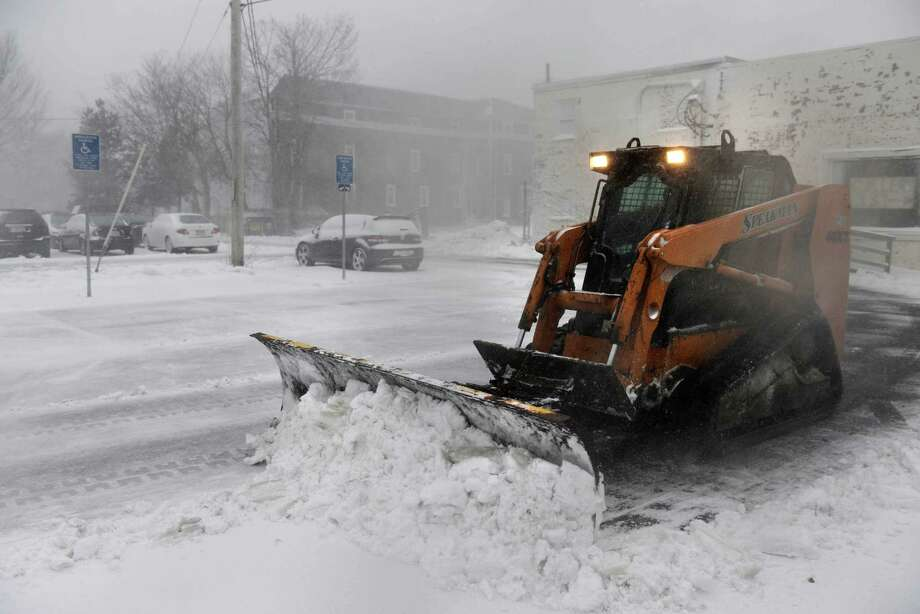 A snowplow clears a parking lot on Ocean Street during a snowstorm March 26, 2014 in Hyannis, Massachusetts. An early spring storm brought high winds and some snow accumulation, with blizzard conditions expected to last throughout the morning. Photo: Darren McCollester, Getty Images / 2014 Getty Images
