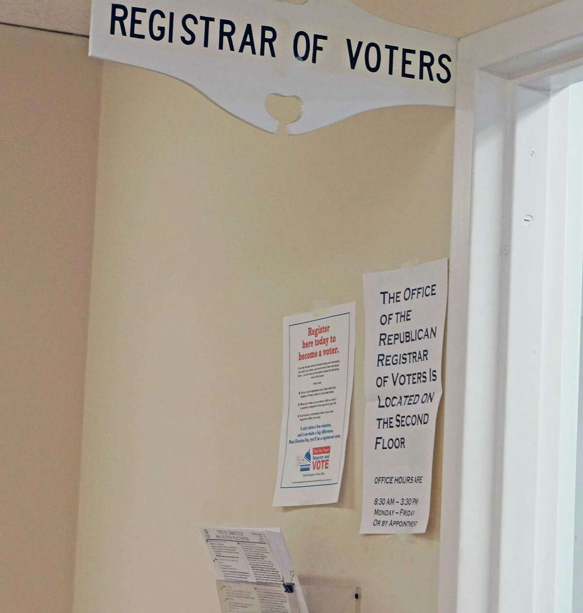 Republican Registrar of Voters Roger Autuori called police Tuesday when this sign indicating his office is located on the second floor of Old Town Hall went missing. It was back up Wednesday.