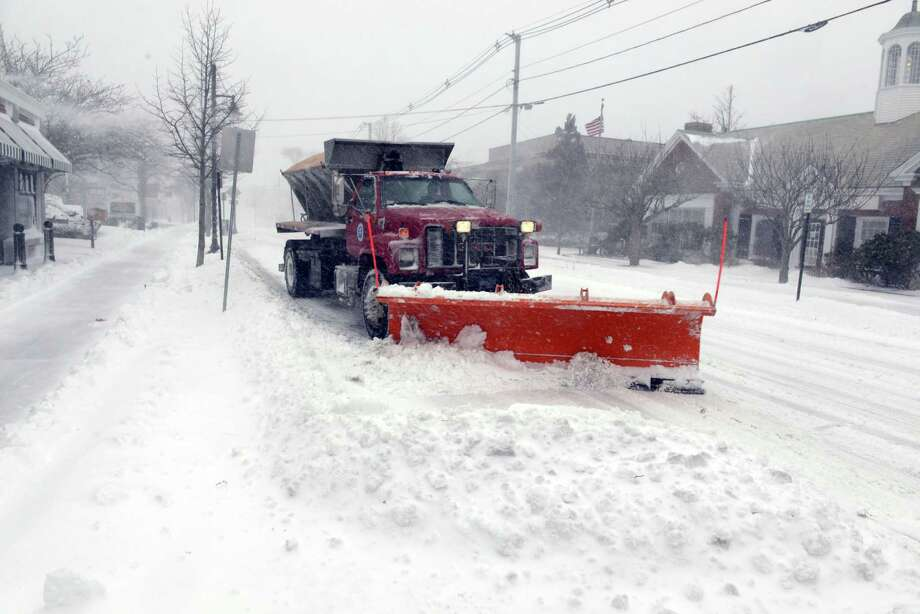 A snow plow piles snow along Main Street during a snowstorm March 26, 2014 in Hyannis, Massachusetts. An early spring storm brought high winds and some snow accumulation, with blizzard conditions expected to last throughout the morning. Photo: Darren McCollester, Getty Images / 2014 Getty Images