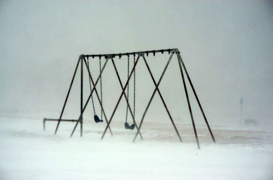 A swing set is seen at Veterans Park Beach during a snowstorm March 26, 2014 in Hyannis, Massachusetts. An early spring storm brought high winds and some snow accumulation, with blizzard conditions expected to last throughout the morning. Photo: Darren McCollester, Getty Images / 2014 Getty Images