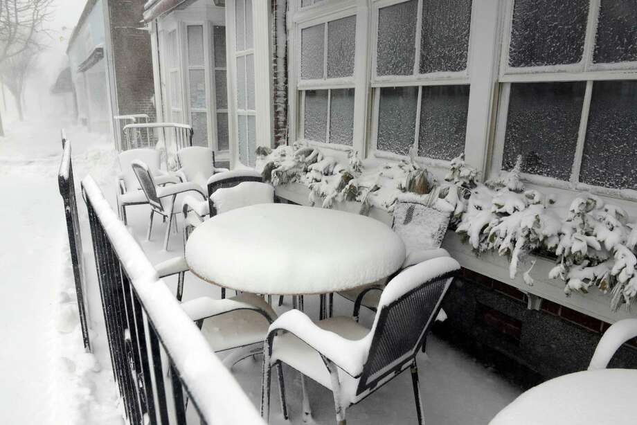 Snow covered tables and chairs are seen at Alberto's Ristorante during a snowstorm March 26, 2014 in Hyannis, Massachusetts. An early spring storm brought high winds and some snow accumulation, with blizzard conditions expected to last throughout the morning. Photo: Darren McCollester, Getty Images / 2014 Getty Images