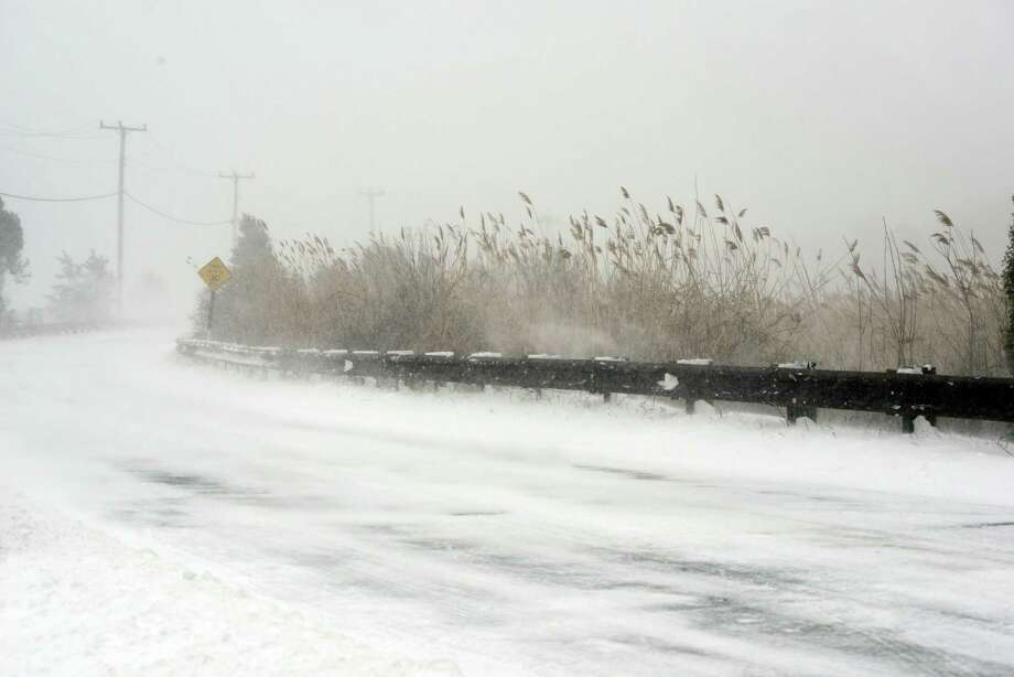 A wind and snow swept Ocean Avenue is seen during a snowstorm March 26, 2014 in Hyannis, Massachusetts. An early spring storm brought high winds and some snow accumulation, with blizzard conditions expected to last throughout the morning. Photo: Darren McCollester, Getty Images / 2014 Getty Images