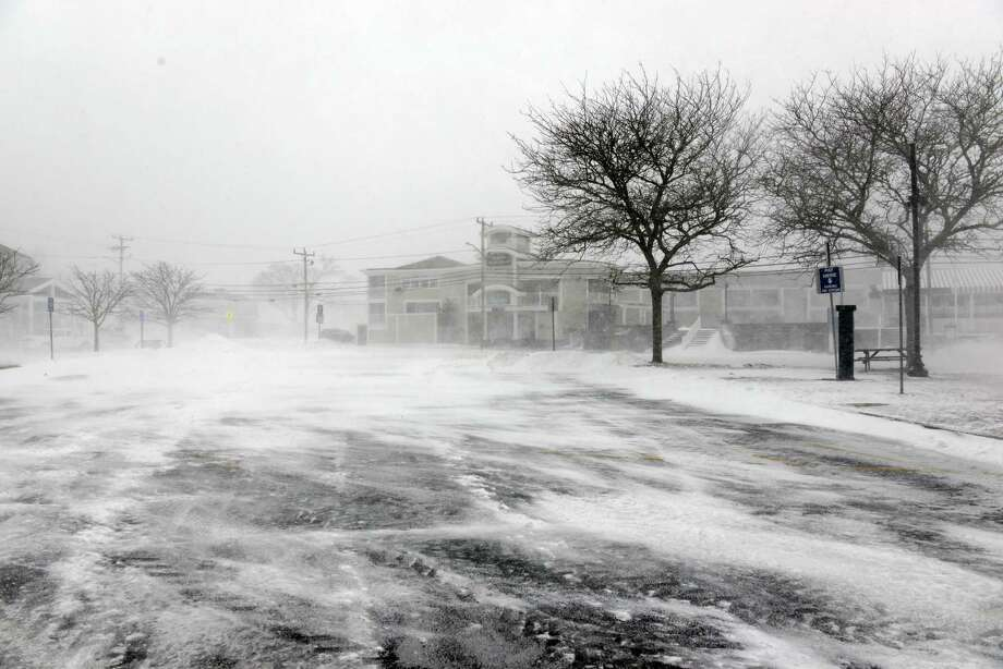 A snow swept parking lot with no cars is seen at the ferry landing in Hyannis harbor during a snowstorm March 26, 2014 in Hyannis, Massachusetts. An early spring storm brought high winds and blizzard conditions, canceling ferries to both Martha's Vineyard and Nantucket. Photo: Darren McCollester, Getty Images / 2014 Getty Images