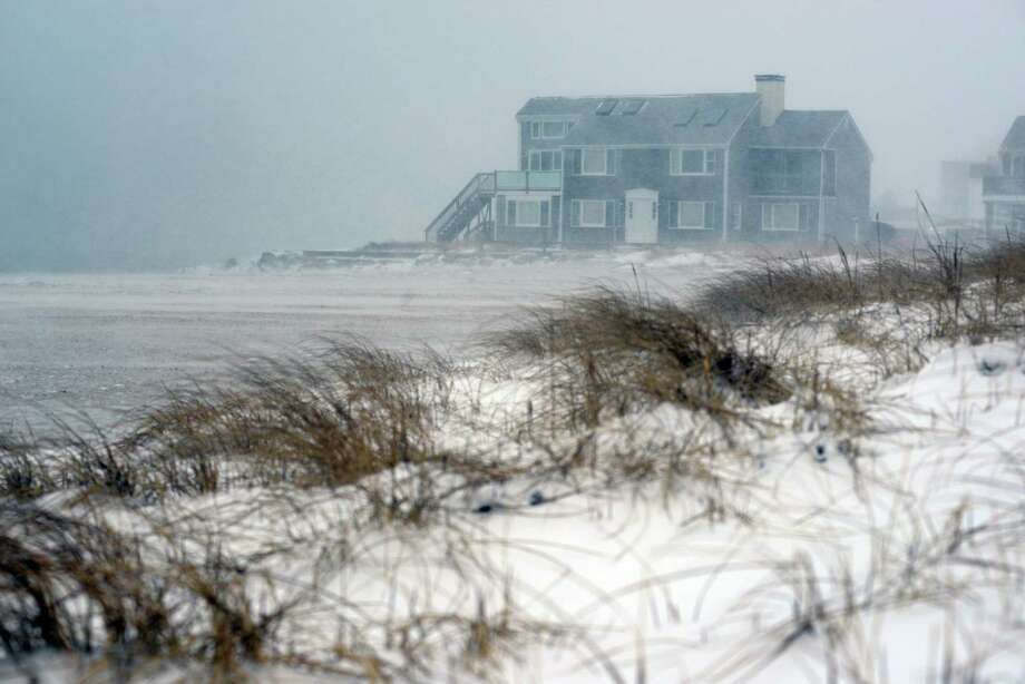 A wind and snow swept beach is seen at Kalmus Park Beach during a snowstorm March 26, 2014 in Hyannis, Massachusetts. An early spring storm brought high winds and some snow accumulation, with blizzard conditions expected to last throughout the morning. Photo: Darren McCollester, Getty Images / 2014 Getty Images