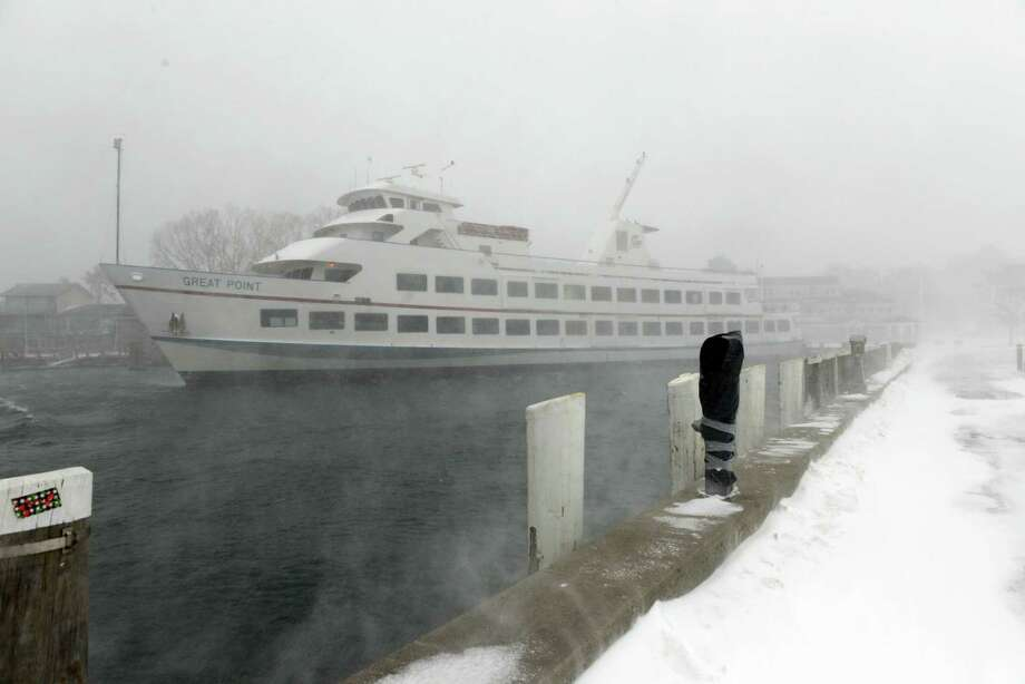 A Hy-Line ferry is seen in Hyannis harbor during a snowstorm March 26, 2014 in Hyannis, Massachusetts. An early spring storm brought high winds and blizzard conditions, canceling ferries to both Martha's Vineyard and Nantucket. Photo: Darren McCollester, Getty Images / 2014 Getty Images