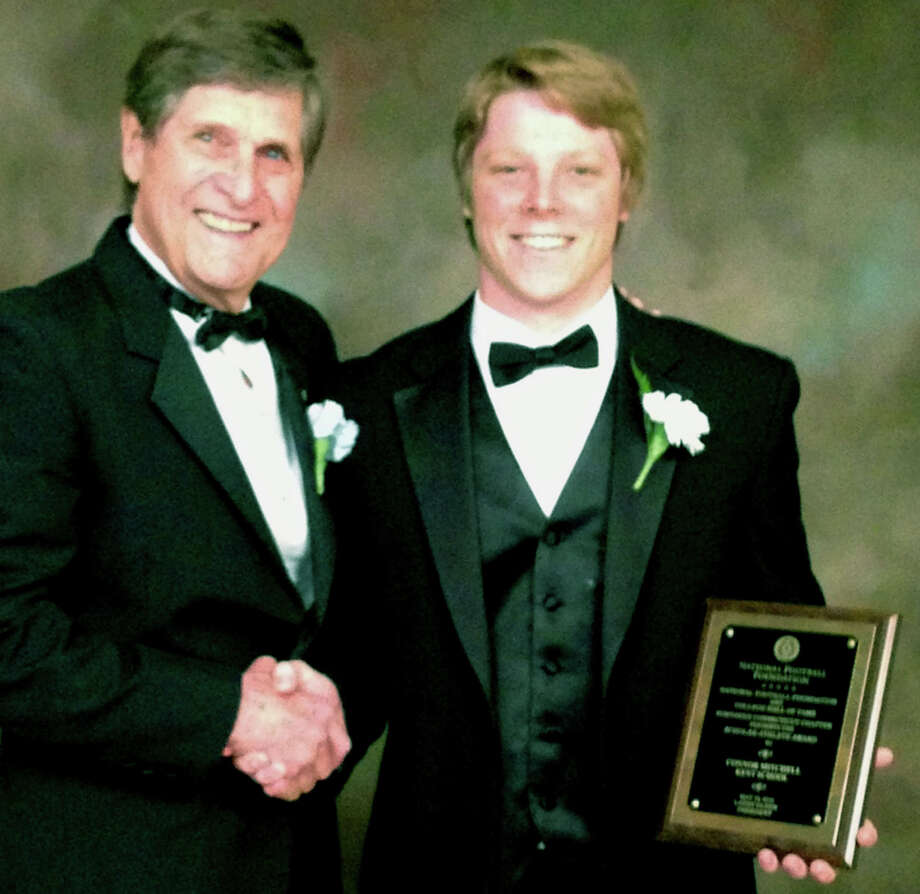 Connor Mitchell of New Milford is honored by Larry Olsen, president of the Northern Connecticut chapter of the National Football Foundation and College Hall of Fame. Photo: Contributed Photo / The News-Times Contributed