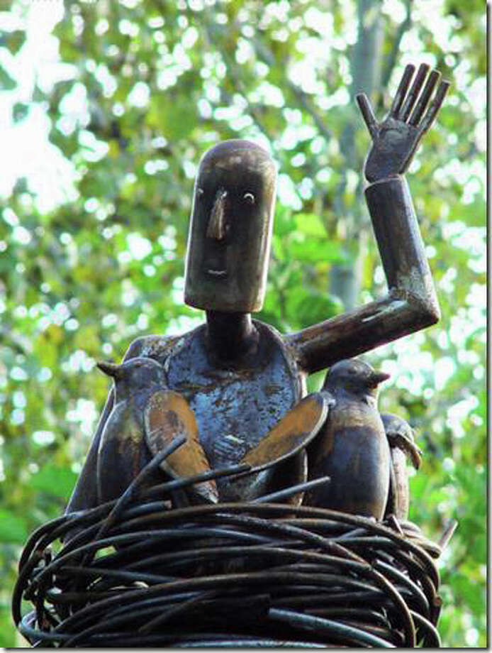 """Joseph,"" a larger-than-life metal sculpture by artist Stephen Cote from Pittsboro, N.C., is one of many artistic features in Ridgefield's Garden of Ideas. Photo: Contributed Photo, Contributed / New Canaan News Contributed"