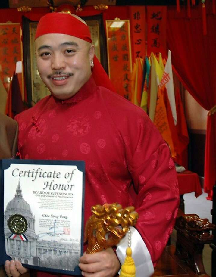 "Raymond ""Shrimpboy'' Chow, who was indicted on racketeering charges in 1992, shows the certificate that was arranged by city Supervisor Fiona Ma. Photo: Special To The Chronicle, SFC"