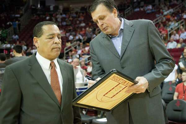 Houston Rockets head coach Kevin McHale, right, confers with assistant coach Kelvin Sampson before an NBA basketball game against the Orlando Magic at Toyota Center on Monday, April 1, 2013, in Houston.