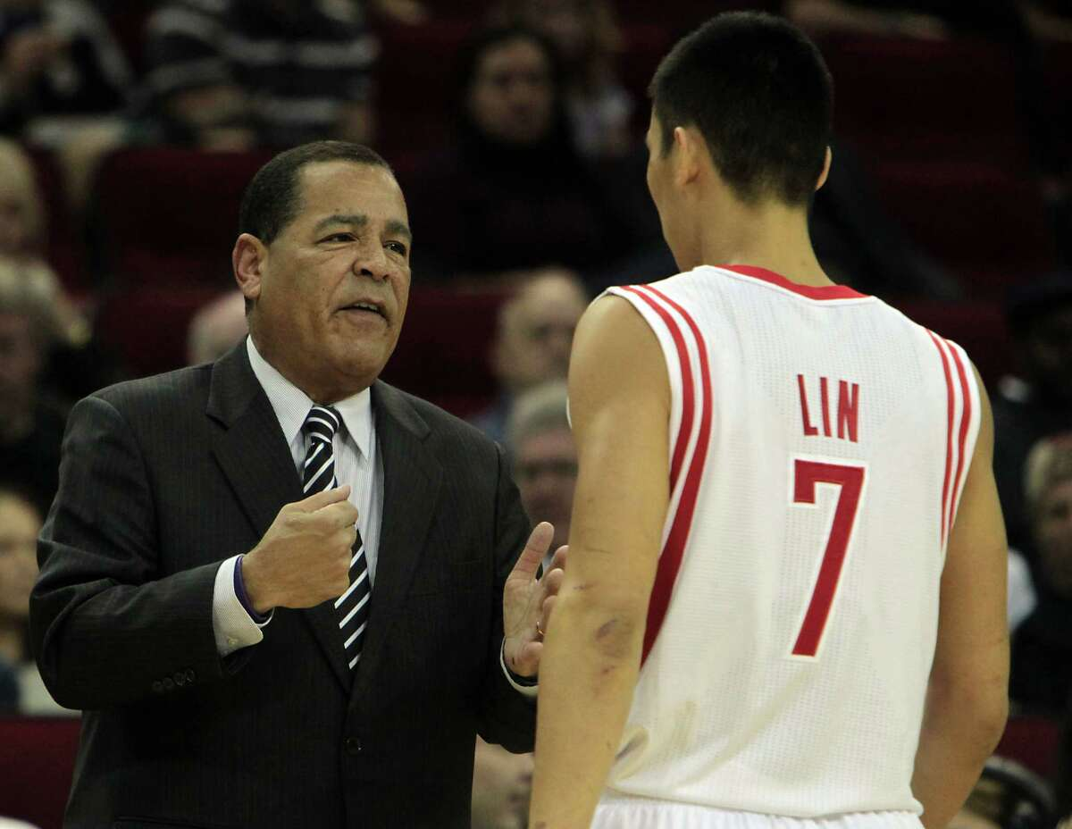 The Houston Rockets acting head coach Kelvin Sampson left, speaks with Jeremy Lin as the Rockets play the Chicago Bulls during the first quarter of NBA game action at the Toyota Center Wednesday, Nov. 21, 2012, in Houston.