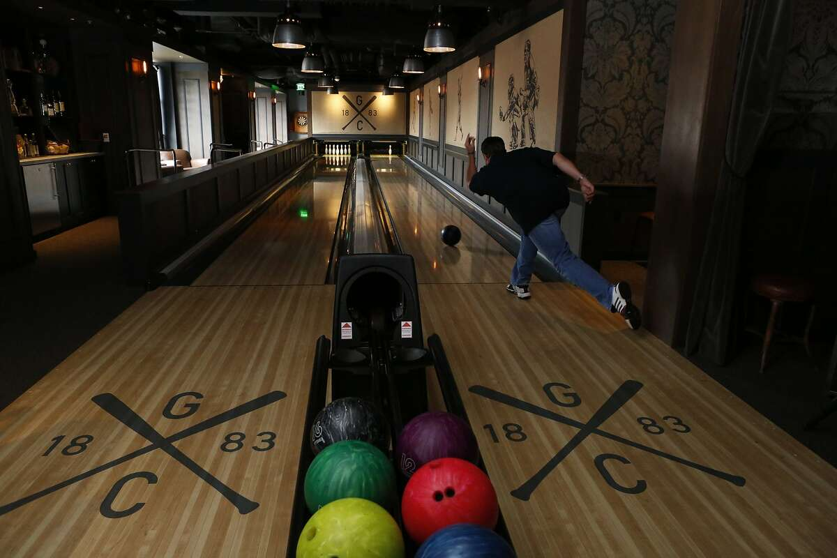 Former San Francisco Giants player JT Snow bowls at the bowling alley inside Gotham Club, a new members-only club inside AT&T Park named after the original team that eventually became the Giants in San Francisco, Calif. on Tuesday, March 25, 2014.