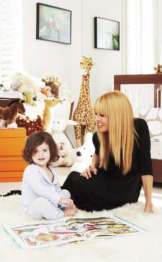 "Hollywood stylist and designer Rachel Zoe reads and plays with her son Skyler. Zoe released her second book on style and fashion ""Living In Style: Inspiration and Advice for Everyday Glamour"" in March 2014. The book is about how she juggles being a mother, wife, designer, stylist, author, entrepreneur and obsessive fashion enthusiast--and doing all that with a little bit of glam. Photo: Courtesy Photo / San Antonio Express-News"