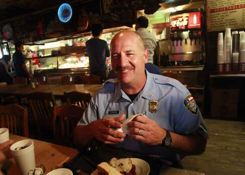 "Houston Fire Dept. Senior Capt. Brad Hawthorne eats at Goode Company, 5109 Kirby Dr., where he paid for his meal despite the restaurant offering free BBQ sandwiches all day to HFD members Wednesday, March 26, 2014 in Houston. Capt. Hawthorne was captured on video rescuing a worker who was trapped by yesterday's apartment fire. Speaking about grabbing the man who jumped from a balcony onto the ladder, he said, ""just another day at the office.""(Melissa Phillip / Houston Chronicle)   Photo: Melissa Phillip, Houston Chronicle"