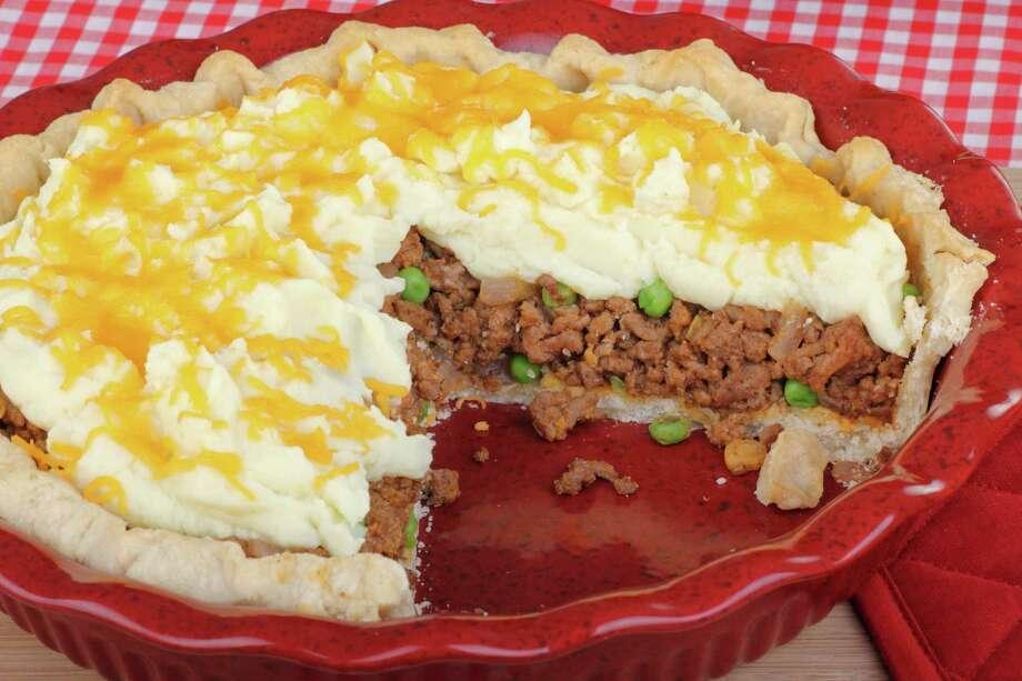 Shepherds pie dinner sliced in baking dish Photo: Charles Brutlag / chas53 - Fotolia