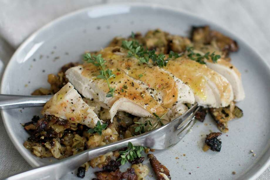 This March 3, 2014 photo shows herbed matzo stuffed roasted chicken. (AP Photo/Matthew Mead) Photo: Matthew Mead / FR170582 AP