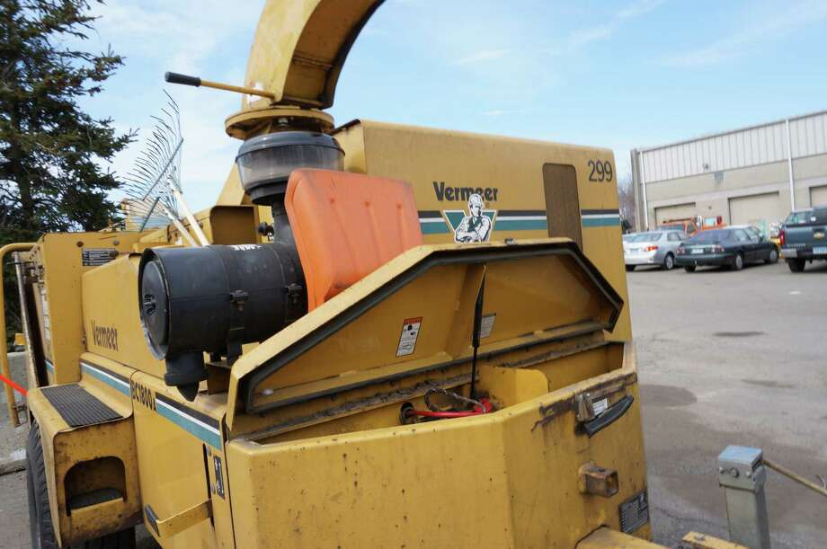 The battery was stolen from this wood chipper in the yard at the Public Works garage, one of seven batteries reported stolen Wednesday. Photo: Genevieve Reilly / Fairfield Citizen
