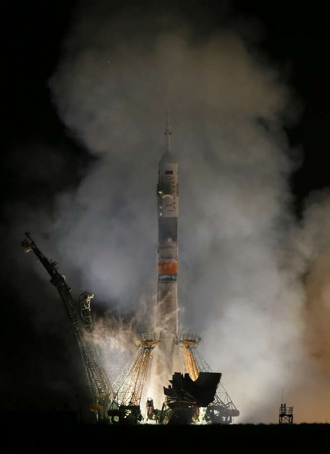 The Soyuz-FG rocket booster with Soyuz TMA-12M space ship carrying a new crew to the International Space Station (ISS) blasts off at the Russian leased Baikonur cosmodrome, Kazakhstan, Wednesday, March 26, 2014. The Russian rocket carries astronaut Steven Swanson, Russian cosmonauts Alexander Skvortsov and Oleg Artemyev. (AP Photo/Dmitry Lovetsky) Photo: Dmitry Lovetsky, Associated Press