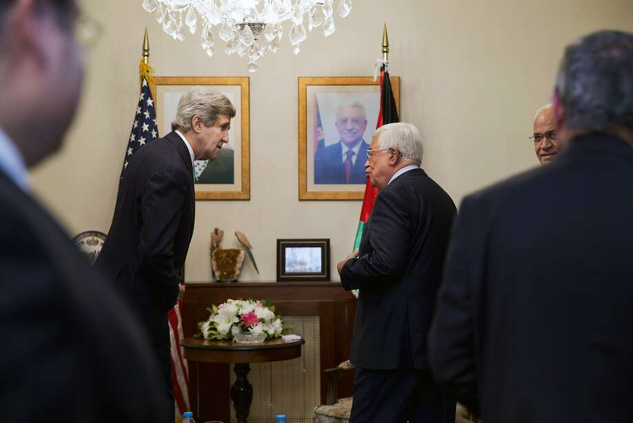 U.S. Secretary of State John Kerry (C-L) meets with Palestinian president Mahmud Abbas (C-R) in the Jordanian capital Amman, on March 26, 2014. Kerry meet with Abbas as he sought to rescue his faltering Middle East peace bid, amid fears Israel may scrap plans to free Palestinian prisoners. AFP PHOTO/JACQUELYN MARTIN-POOLJACQUELYN MARTIN/AFP/Getty Images Photo: Jacquelyn Martin, AFP/Getty Images