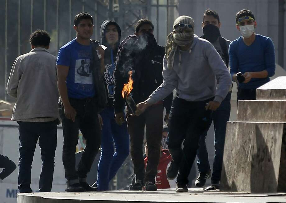 Student supporters of the Muslim Brotherhood clash with police outside Cairo University. Photo: Amr Abdallah Dalsh, Reuters