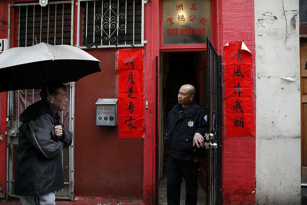 An SFPD officer is seen in the doorway of the Ghee Kung Tong Chinese Free Masons Temple in Chinatown that was the target of a raid related to Sen. Leland Yee's arrest, San Francisco, CA, Wednesday Mar. 26, 2014.The FBI raids State Sen. Leland Yee's office in Sacramento and other locations were searched by the FBI in San Francisco. He was reportedly arrested on public corruption charges Wednesday morning amid raids of his office in Sacramento and searches by the FBI in San Francisco. Photo: Michael Short, The Chronicle