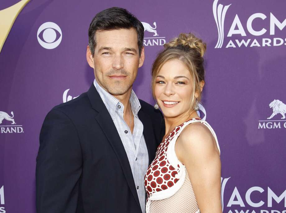 LeAnn Rimes and her husband Eddie Cibrian, like Tori Spelling and Dean McDermot, publicly started their relationship while they were both married to other people. You'd think in light of that they might keep a lower profile in married life but no. The singer-actress's Twitter feed is embarrassingly over-exposing at times, save some details for the songwriting LeAnn. Photo: Isaac Brekken, Associated Press