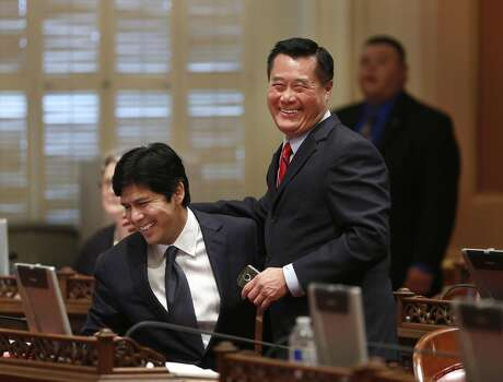 State Senator Leland Yee, D-San Francisco, right, and Sen. Kevin de Leon, D-Los Angeles, celebrate the passage of their gun control measures  during the Senate session at the Capitol in Sacramento, Calif., Wednesday, May 29, 2013.  Democrats in the state Senate passed a series of firearms bills including de Leon's SB53 which requires ammunition buyers to get a permit, have a background check and pay a fee, and Yee's SB47 which prohibits so-called bullet buttons and other devices that allows swift reloading of ammunition magazines. Photo: Rich Pedroncelli, AP