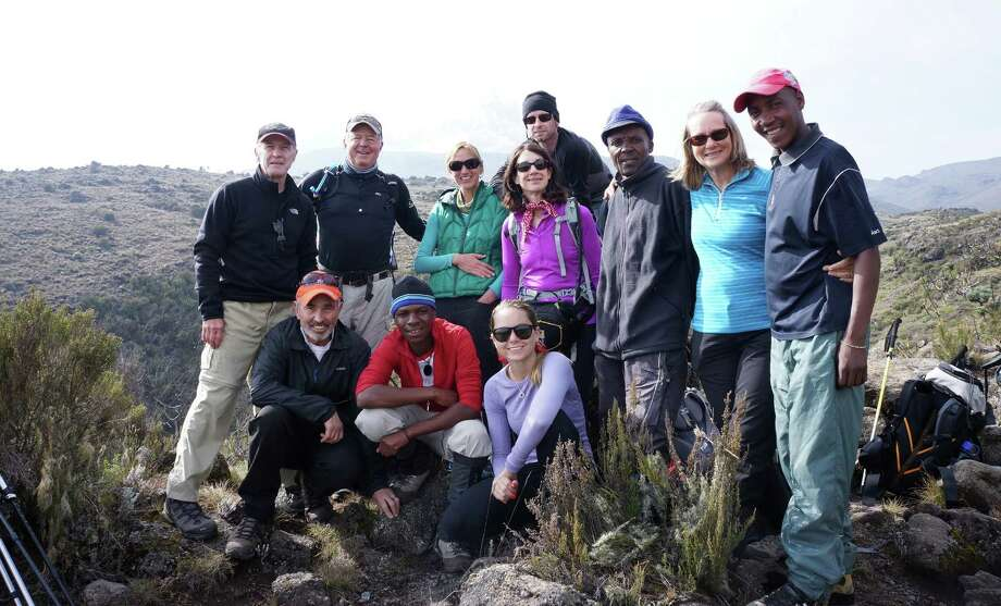 New Canaan resident Emily Kelting (in the pink shirt) getting ready to climb Mount Kilimanjaro in Tanzania on Feb. 16, 2014. Kelting climbed to the highest point in Africa with a group of friends from Idaho and four guides. Photo: Contributed Photo, Contributed / New Canaan News Contributed