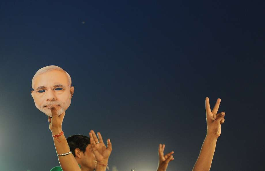 A head in the polls:The mask of opposition prime minister candidate Narendra Modi is waved at a Bharatiya Janata Party election rally in New Delhi. Photo: Sajjad Hussain, AFP/Getty Images