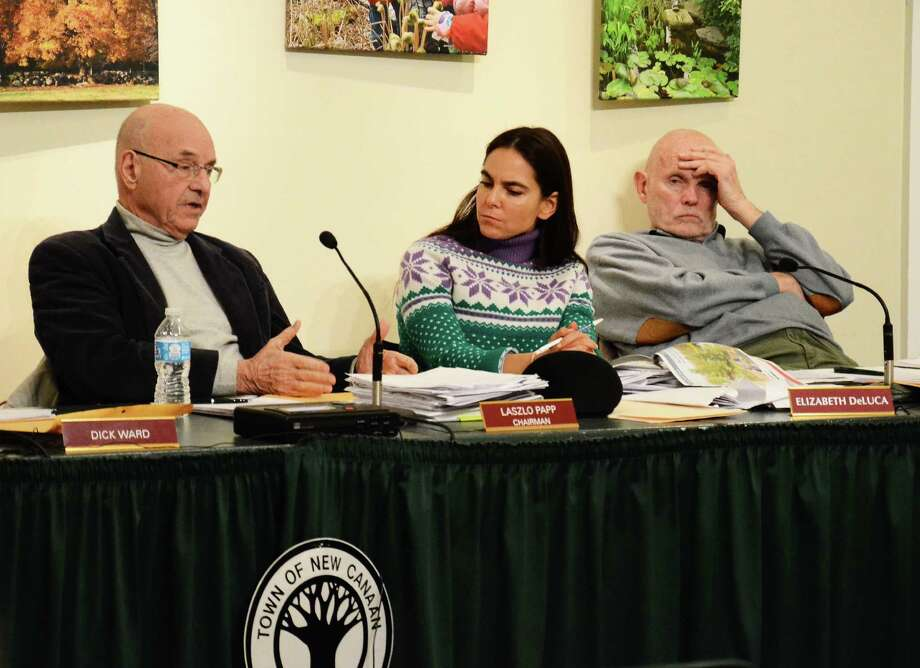 Planning and Zoning Commission Chairman Laszlo Papp, left, and members Elizabeth DeLuca and David Scannell at a meeting at the Nature Center in New Canaan, Conn., Tuesday, March 25, 2014. The commission considered a number of conditions for the potential approval of a YMCA renovation project. Photo: Nelson Oliveira / New Canaan News