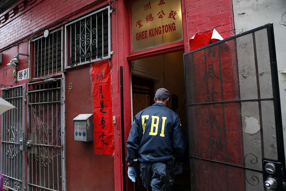 An FBI agent enters the Ghee Kung Tong Chinese Free Masons Temple in Chinatown during a raid related to Sen. Leland Yee's arrest, San Francisco, CA, Wednesday Mar. 26, 2014. The FBI raids State Sen. Leland Yee's office in Sacramento and other locations were searched by the FBI in San Francisco. He was reportedly arrested on public corruption charges Wednesday morning amid raids of his office in Sacramento and searches by the FBI in San Francisco. Photo: Michael Short, The Chronicle