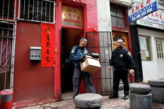 An FBI agent carries boxes of evidence out of the Ghee Kung Tong Chinese Free Masons Temple in Chinatown during a raid related to Sen. Leland Yee's arrest, San Francisco, CA, Wednesday Mar. 26, 2014. The FBI raids State Sen. Leland Yee's office in Sacramento and other locations were searched by the FBI in San Francisco. He was reportedly arrested on public corruption charges Wednesday morning amid raids of his office in Sacramento and searches by the FBI in San Francisco. Photo: Michael Short / The Chronicle / ONLINE_YES