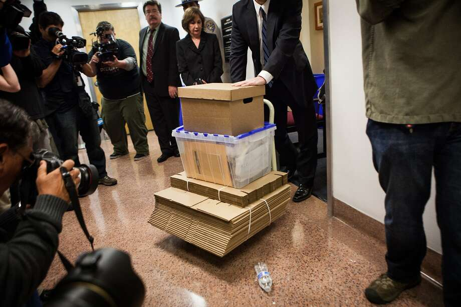 An FBI agent wheels boxes of evidence out of Senator Leland Yee's office at the State Capitol in Sacramento, California, March 26th.  The offices will remain open until June. Photo: Max Whittaker/Prime, Special To The Chronicle