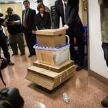An FBI agent wheels boxes of evidence out of Senator Leland Yee's office at the State Capitol in Sacramento, California, March 26, 2014.