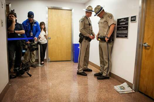 California Highway Patrol officers stand guard outside state Sen. Leland Yee's office at the Capitol during an FBI search. Photo: Max Whittaker/Prime, Special To The Chronicle