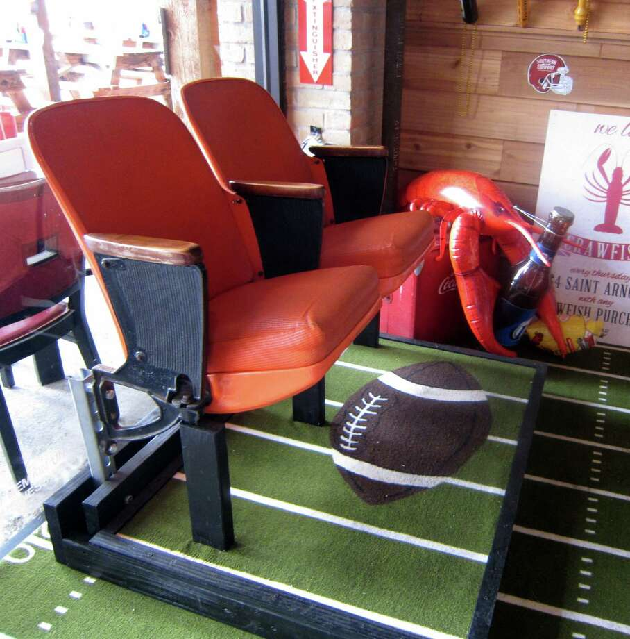 The Refinery has added stadium seating - two old Astrodome chairs - to its dining room. Photo: Syd Kearney / ONLINE_YES