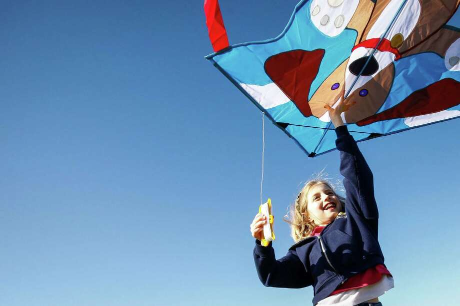 Odile Gabbiani, 9, plays with her new birthday kite she received two days earlier while at Hermann Park on an unseasonably warm day, Saturday, Jan. 28, 2012, in Houston.  ( Michael Paulsen / Houston Chronicle ) Photo: Michael Paulsen, Staff / © 2011 Houston Chronicle