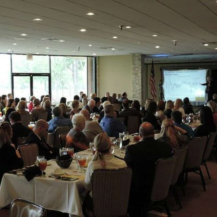 People listen to a presentation during the Lake Houston Area Chamber of Commerce's Third Tuesday Luncheon.