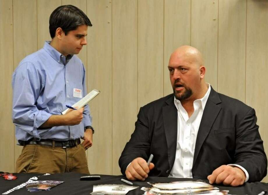 Sports editor Pete Iorizzo with WWE wrestler The Big Show. Photo: Times Union Photo Staff