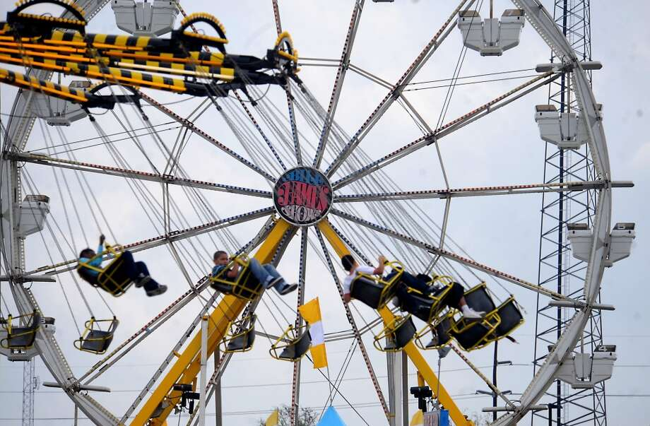 Visitors enjoy the number and variety of rides available at the South Texas State Fair at Ford Park in April. Enterprie file photo