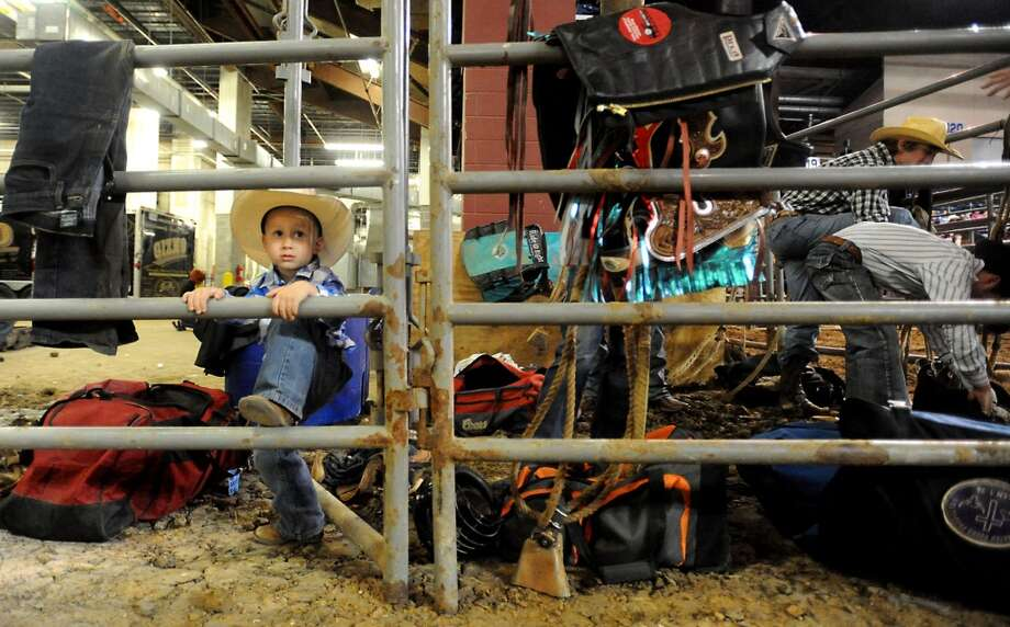Stetsn Griffin (4) hangs out with the cowboys getting ready to ride in the bareback competition during the 2010 YMBL Championship Rodeo at theSouth Texas State Fair at Ford Park in Beaumont, Friday, Tammy McKinley/ The Enterprise Photo: Tammy McKinley/ The Enterprise