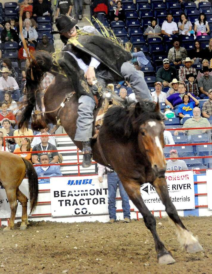 Cody Ziober competes in the bareback riding competition during the South Texas State Fair YMBL Rodeo at Ford Park Iin April. Enterprise file photo