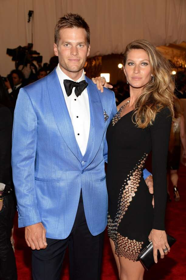 Mr. And Mrs. Stepford, I mean Tom Brady and Gisele Bundchen, just seem too perfect to be real: and a little smug about it. The humorless couple are nice to look at though. Photo: Dimitrios Kambouris, Getty Images