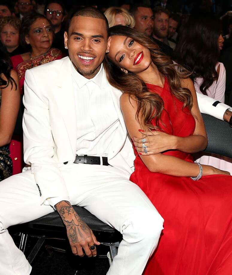 Chris Brown and Rihanna have... a lot of history, let's just leave it at that. Knowing the scrutiny he's under by the media in light of his history with domestic violence Chris Brown continues to behave ungraciously. Photo: Christopher Polk, Getty Images For NARAS