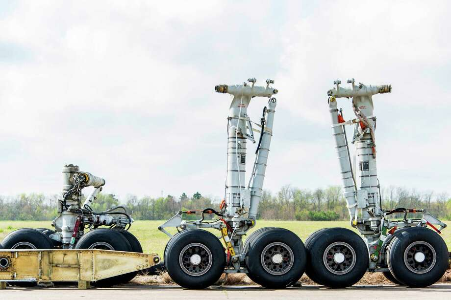 Landing gear from the NASA Shuttle Carrier Aircraft on a taxiway at Ellington Field where the aircraft is being dismantled.  Photo: Smiley N. Pool, Houston Chronicle / © 2014  Houston Chronicle