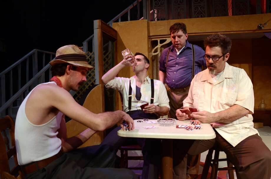 "Jody Reho as Pablo, Michael Mason as Stanley Kowalski, Michael Saar as Mitch and Scott Eslinger as Steve rehearse a poker game scene in ""A Streetcar Named Desire."" The Beaumont Community Players production runs March 28-April 12.  Photo provided by Pete Churton/BCP Photo: Pete Churton/BCP"
