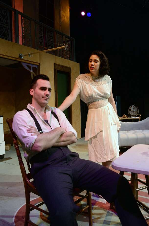 "Michael Mason (seated) as Stanley Kowalski and Jade Oliver as Blanche DuBois, his sister-in-law, rehearse an early scene from ""A Streetcar Named Desire."" The Beaumont Community Players production runs March 28-April 12.  Photo provided by Pete Churton/BCP Photo: Pete Churton/BCP"