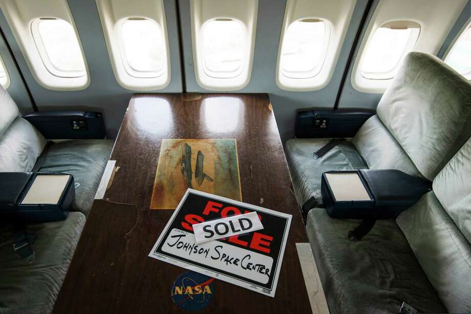 A sold sign left behind as a humorous nod to the transfer of the NASA Shuttle Carrier Aircraft to Space Center Houston sits in a passenger area of the aircraft at Ellington Field.  Photo: Smiley N. Pool, Houston Chronicle / © 2014  Houston Chronicle